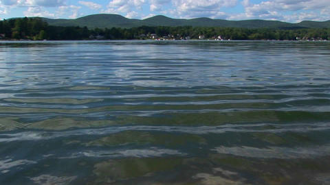 Mountains and trees are seen in the distance of a glassy... Stock Video Footage