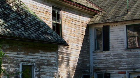 An old abandoned house with broken windows at day Stock Video Footage