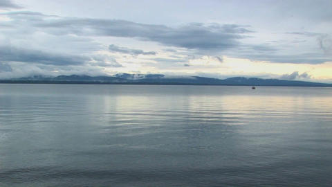 Smooth water ripples under a grey sky at Lake Champlain... Stock Video Footage