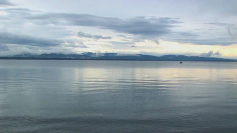 Smooth water ripples under a grey sky at Lake Champlain in Vermont Footage