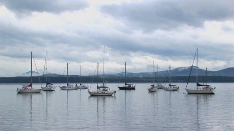Clouds cover a mountain range in the distance of... Stock Video Footage