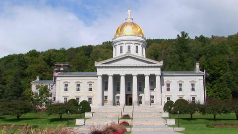Trees surround the gold domed capital building in Montpelier, Vermont Footage