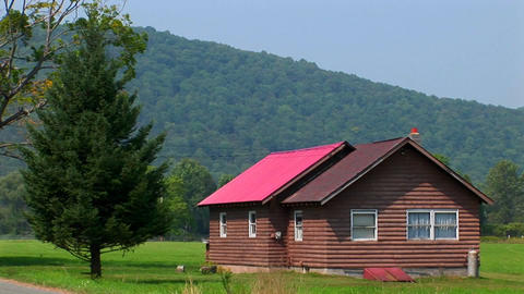 A cabin in the middle of a green field near the Allegheny... Stock Video Footage
