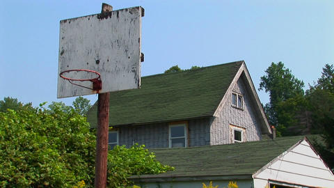 An old basketball hoop near a house Footage