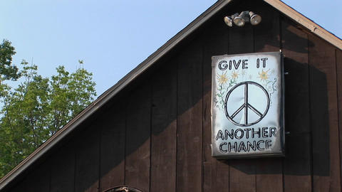 A brown barn with a peace sign in Woodstock, New York Footage