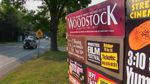 A Woodstock sign next to a street in Woodstock, New York Stock Video Footage