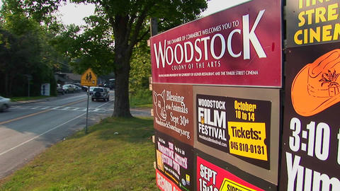 A Woodstock sign next to a street in Woodstock, New York Footage