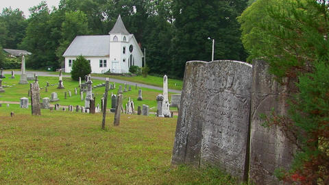 New England graveyard markers stand in an old cemetery... Stock Video Footage