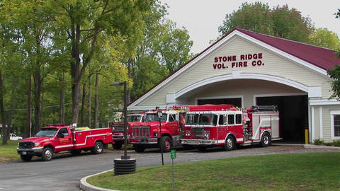 Vehicles drive pass the Stone Ridge Volunteer Fire Company Stock Video Footage