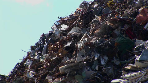 Vehicles drive pass a high pile of waste Footage