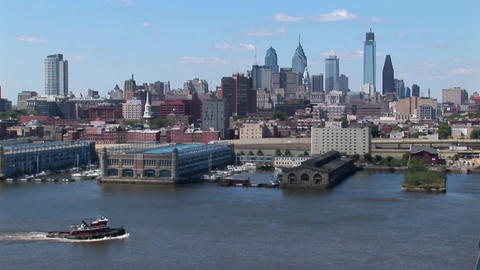 A boat passes by the Ben Franklin Bridge that leads to... Stock Video Footage