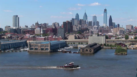 A boat passes by the Ben Franklin Bridge that leads to Philadelphia, Pennsylvania Footage