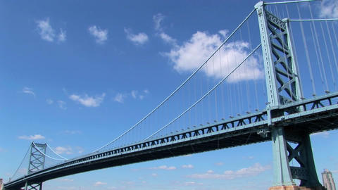 A time lapse of clouds moving over the Ben Franklin Bridge which leads to Philadelphia, Pennsylvania Footage