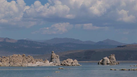 Clouds are above tufa formations sitting in water while... Stock Video Footage
