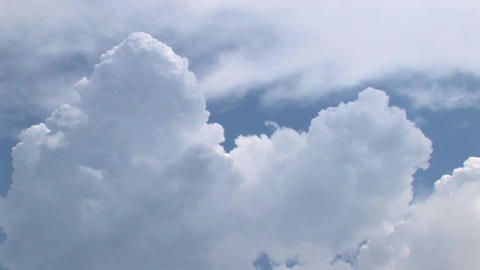 A time lapse of thunderclouds expanding in a blue sky Footage