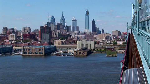 A rapid transit train drives across Ben Franklin Bridge away from Philadelphia, Pennsylvania Footage