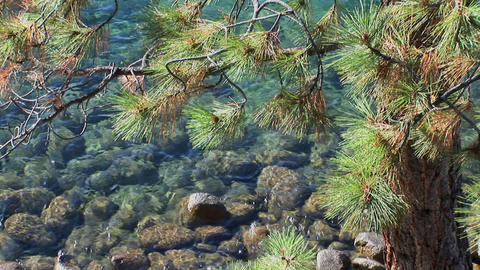 Water in Lake Tahoe undulates over rocks near the... Stock Video Footage