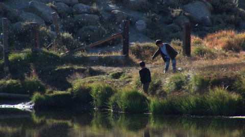 young boys explore a lake near the Sierra Nevada Mountains Footage