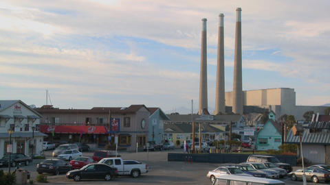 The town of Morro Bay in California with industrial smokestacks in background Footage