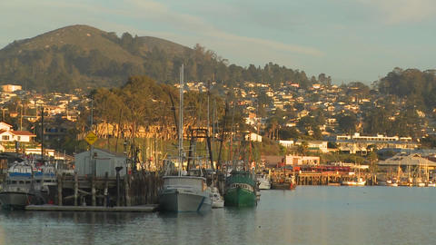 The small Central California town of Morro Bay with fishing boats in the harbor Footage