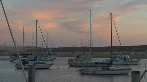 Boats sit in the harbor at Morro Bay, California Footage