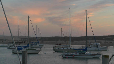 Boats sit in the harbor at Morro Bay, California Stock Video Footage