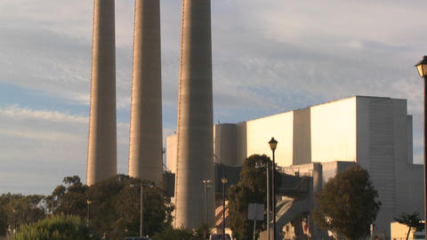 A slow tilt up to the towers of a power plant Stock Video Footage