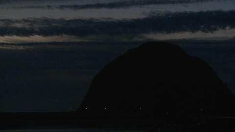 A time lapse shot over a dark round mountain at Morro... Stock Video Footage