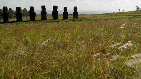 A panning shot reveals Easter Island's mystical statues Stock Video Footage