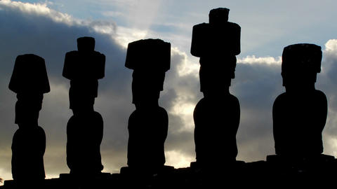 Clouds move mysteriously behind Easter Island statues Stock Video Footage
