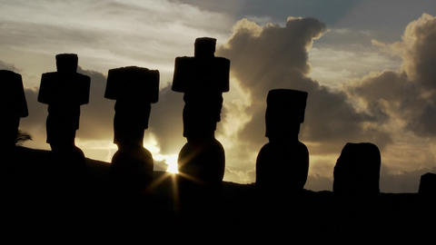 The sun peeks out from behind an Easter Island statue Footage