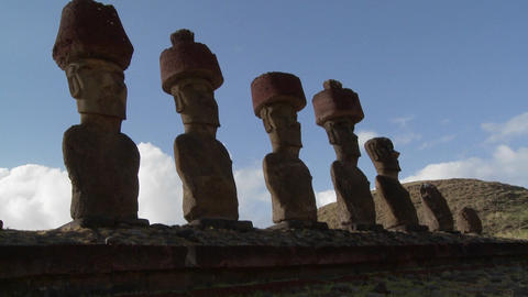 Easter Island statues stand in a long row Stock Video Footage