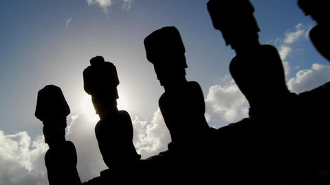 Easter Island statues are silhouetted against the sky Footage