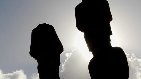 Easter Island statues are silhouetted against the sky Stock Video Footage