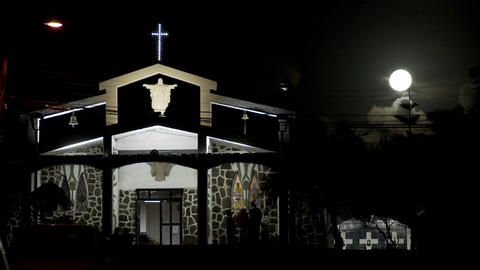 Moonlight shines down on a South Pacific church Footage
