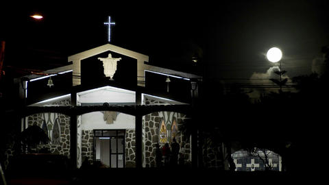 Moonlight shines down on a South Pacific church Stock Video Footage