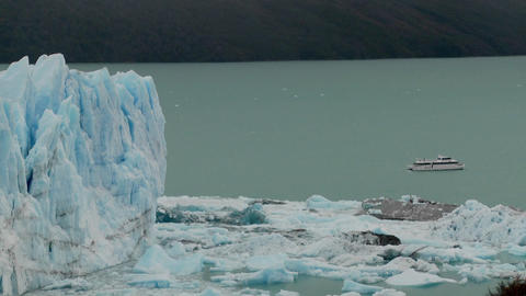 A boat sits near the side of a giant glacier in Patagonia, Argentina Footage