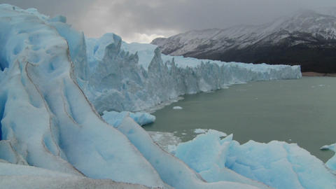 Pan across the lip of a glacier Stock Video Footage