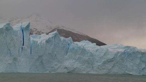 POV from a boat traveling along the edge of a glacier Stock Video Footage