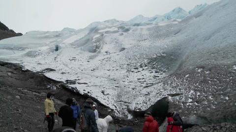 Hikers gather at the base of a glacier for a trek Stock Video Footage