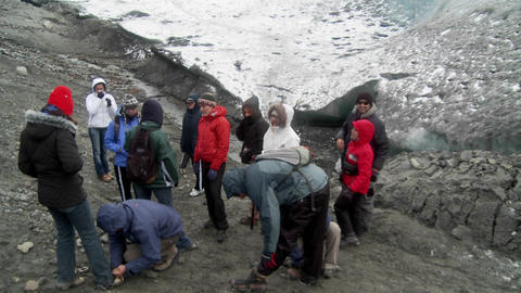 A Group Hikers Prepares To Scale A Glacier stock footage