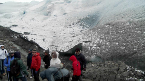 A group hikers prepares to scale a glacier Stock Video Footage