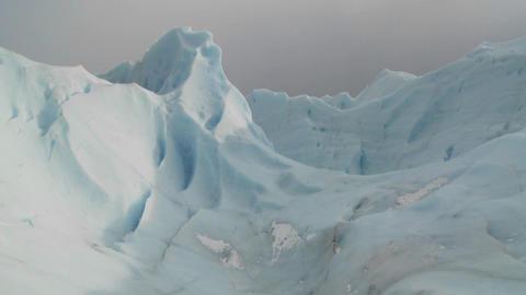 An ice mountain atop a glacier Stock Video Footage