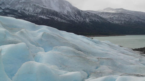 A scene from the top of a glacier across distant mountains Footage