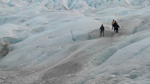 An expedition moves across a glacier landscape Stock Video Footage