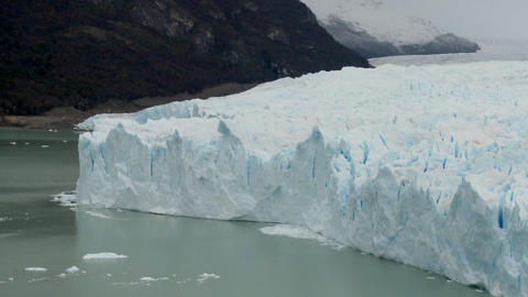 A view of the front rim of a glacier where it meets the sea Footage