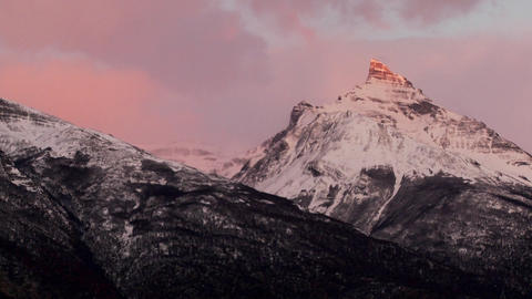 Sunrise over snowy mountains Footage