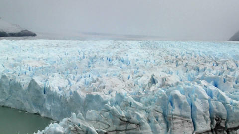 Pan across a vast arctic glacier with ice stretching into... Stock Video Footage