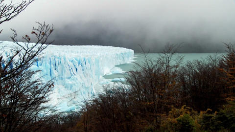 Clouds and fog appear above a glacier Stock Video Footage