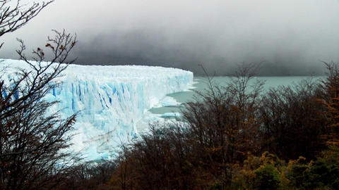Clouds and fog appear above a glacier Footage